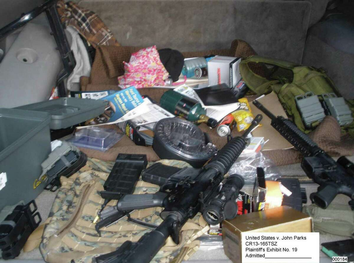 Weapons and ammunition recovered by authorities during the investigation into John Christian Parks, pictured in a Department of Justice photo.