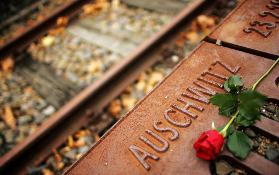 A red rose lies at Gleis 17 (platform 17) holocaust memorial at a former cargo railway station in Berlin-Grunewald November 9, 2006, to mark the Kristallnacht, or Night of Broken Glass, when Nazi propaganda chief Josef Goebbels delivered the incendiary speech that unleashed the November 9-10 pogrom in 1938. Hundreds of synagogues were destroyed across Germany and in parts of Austria, Jewish homes and stores were ransacked and Jews were attacked and beaten to death. From Gleis 17 October 1941 to February 1945, more than 50,000 Berlin Jews were loaded into trains and transported to the Nazi concentration camps, such as Auschwitz. Photo: HANNIBAL HANSCHKE, REUTERS