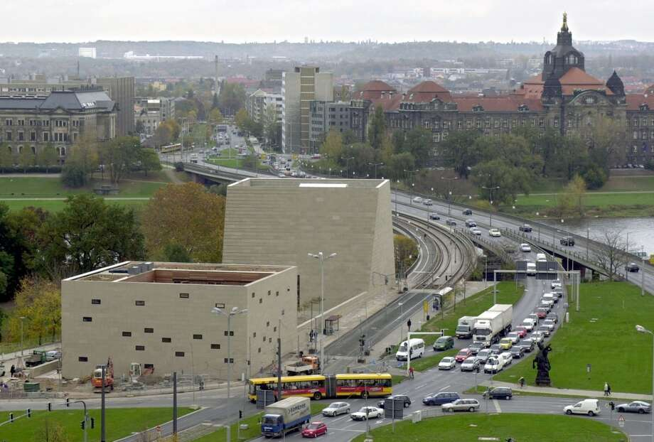 General view of a new synagogue, center, and the building of the Jewish parish, left, are shown in Dresden, eastern Germany, on Wednesday, Nov. 7, 2001.The inauguration of the synagogue takes place on Friday, 63 years after the Nazis burned synagogues in Germany, in a rampage known as Kristallnacht. At right in the background is Saxony's state chancellory. (AP Photo/Matthias Rietschel) Photo: MATTHIAS RIETSCHEL, AP