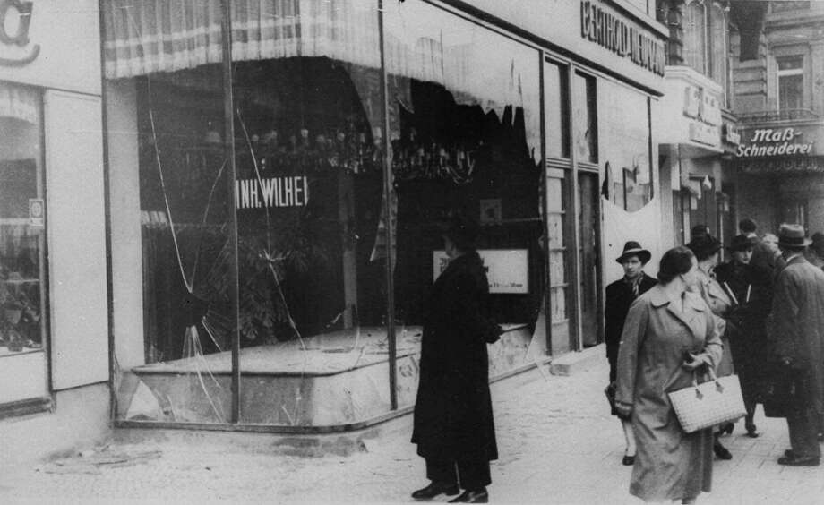 A pedestrian looks at the wreckage of a Jewish shop in Berlin Nov. 10, 1938, the day after the 'Kristallnacht' rampage, when Nazi thugs set fire to hundreds of synagogues, looted thousands of Jewish businesses and attacked Jews in Germany and Austria. Germany's remembrance of the Nov. 9, 1938 terror, the ``Night of Broken Glass,'' comes amid fresh debate on the nation's relationship with its past--triggered by the government's return to Berlin, the prewar capital from which Adolf Hitler ruled.(APPhoto) Photo: AP