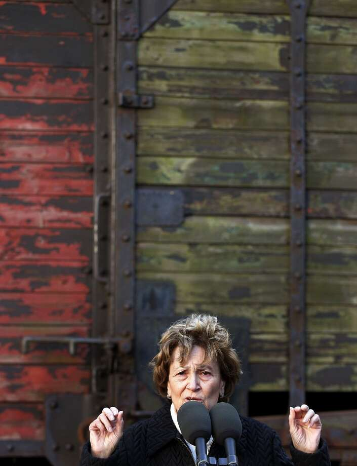 Holocaust survivor Fritzie Fritzshall gestures as she speaks to the media about her transportation in boxcars during the Holocaust in front of what is believed to be a German boxcar used during the Holocaust Nov. 9, 2005 in Chicago, Illinois. At the age of 13, Fritzshall was transported to Auschwitz-Birkenau extermination camp and was later liberated by the Russian army while on a death march from the camp. She lost her mother, two younger brothers and other family members in the Holocaust. The boxcar unveiling was part of a program for the 57th anniversary of Kristallnacht and will be a cornerstone for a new Holocaust museum to be built in Skokie, Illinois. (Photo by Tim Boyle/Getty Images) *** Local Caption *** Fritzie Fritzshall Photo: Tim Boyle, Getty Images
