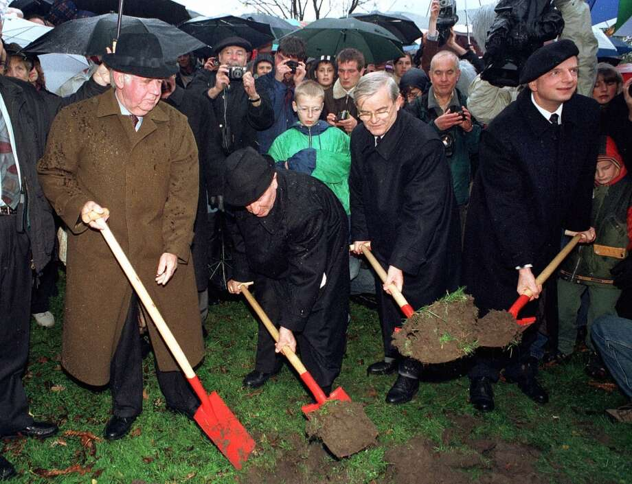 Kurt Biedenkopf, governor of the German State of Saxony, Roman Koenig, president of Dresden's Jewish parish, Erich Iltgen, Saxony's state parliament speaker, and Herbert Wagner, mayor of Dresden, from left to  right, cut the first turf for the construction of a new Jewish synagogue in the eastern German town of Dresden Monday, Nov. 9, 1998. Sixty years after the Nazis burned the synagogues in Germany, in a rampage known as 'Kristallnacht', new ground was broken for a new synagogue on the site of the old one in Dresden. (AP Photo/Matthias Rietschel) Photo: MATTHIAS RIETSCHEL, AP