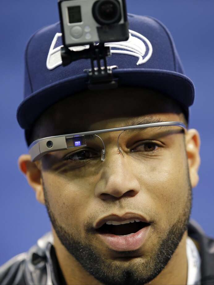 Seattle Seahawks' Golden Tate wears Google glasses during media day for the NFL Super Bowl XLVIII football game Tuesday, Jan. 28, 2014, in Newark, N.J. (AP Photo/Matt Slocum) Photo: Matt Slocum, AP