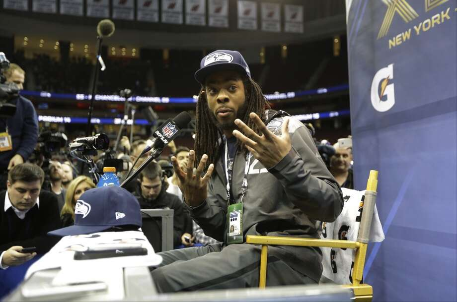 Seattle Seahawks' Richard Sherman answers a question during media day for the NFL Super Bowl XLVIII football game Tuesday, Jan. 28, 2014, in Newark, N.J. (AP Photo/Jeff Roberson) Photo: Jeff Roberson, AP