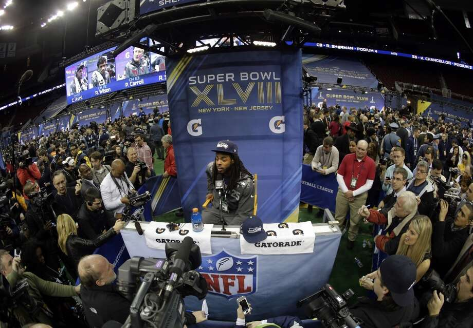 Seattle Seahawks' Richard Sherman answers a question during media day for the NFL Super Bowl XLVIII football game Tuesday, Jan. 28, 2014, in Newark, N.J. (AP Photo/Charlie Riedel) Photo: Charlie Riedel, AP