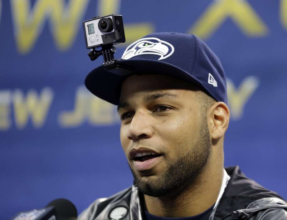 Seattle Seahawks' Golden Tate wears a camera on his hat as he speaks during media day for the NFL Super Bowl XLVIII football game Tuesday, Jan. 28, 2014, in Newark, N.J. (AP Photo/Jeff Roberson) Photo: Jeff Roberson, AP