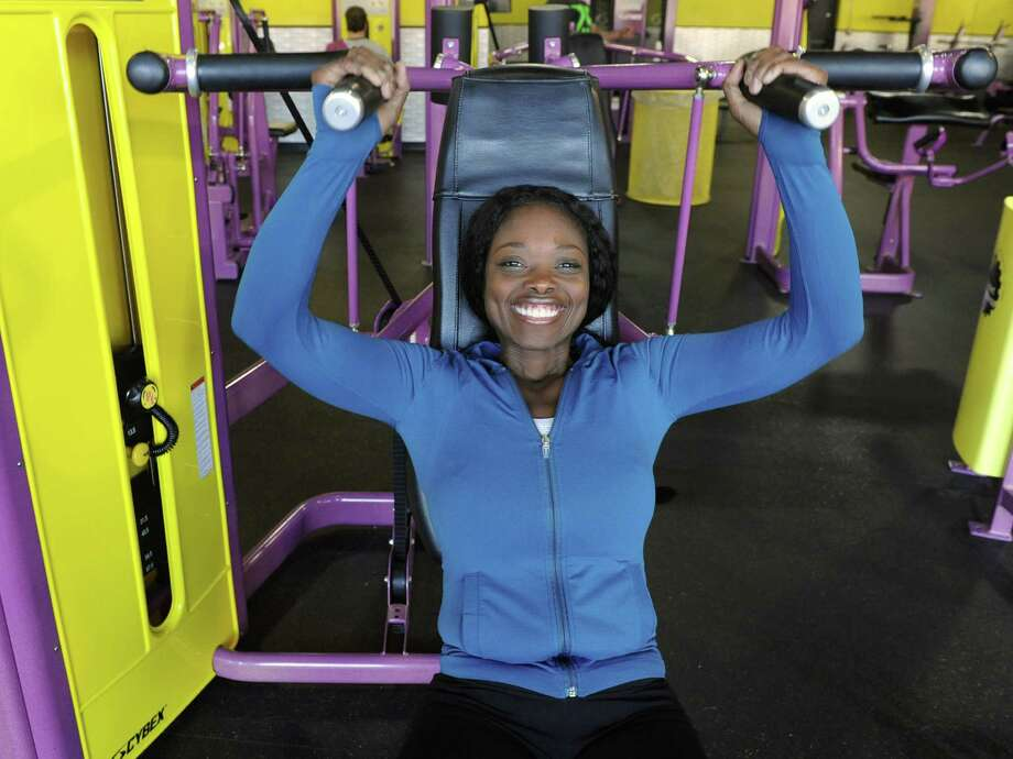"Tumi Oguntala, of Clifton Park, works out at a Planet Fitness on Friday Jan. 17, 2014 in Clifton Park, N.Y. Tumi is a contestant on NBC's ""The Biggest Loser"" and was voted off recently. She's still in the running for $100,000 as an at-home contestant. (Lori Van Buren / Times Union) Photo: Lori Van Buren / 00025413A"