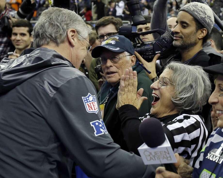 Teresa Dahlquist reacts after getting a hug from Seattle Seahawks head coach Pete Carroll during media day for the NFL Super Bowl XLVIII football game Tuesday, Jan. 28, 2014, in Newark, N.J. (AP Photo/Matt Slocum) Photo: Matt Slocum, ASSOCIATED PRESS