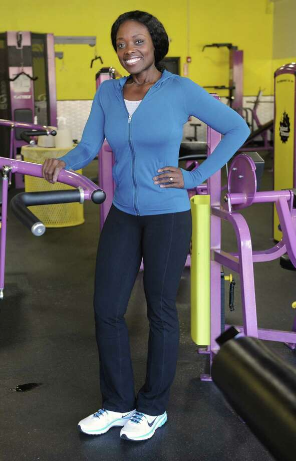 "Tumi Oguntala, of Clifton Park, shows off her new body at a Planet Fitness on Friday Jan. 17, 2014 in Clifton Park, N.Y. Tumi is a contestant on NBC's ""The Biggest Loser"" and was voted off recently. She's still in the running for $100,000 as an at-home contestant. (Lori Van Buren / Times Union) Photo: Lori Van Buren / 00025413A"
