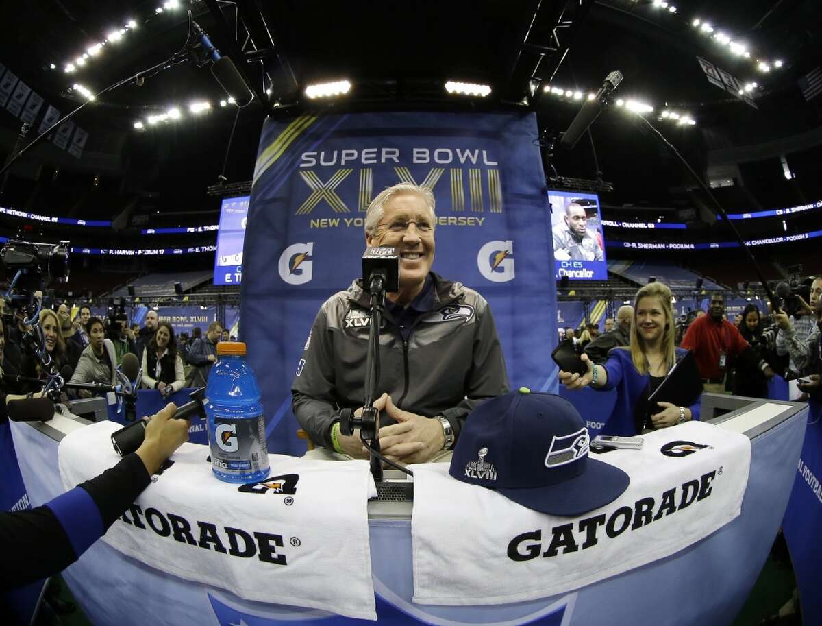 Seattle Seahawks head coach Pete Carroll smiles during media day for the NFL Super Bowl XLVIII football game Tuesday, Jan. 28, 2014, in Newark, N.J. (AP Photo/Matt Slocum)