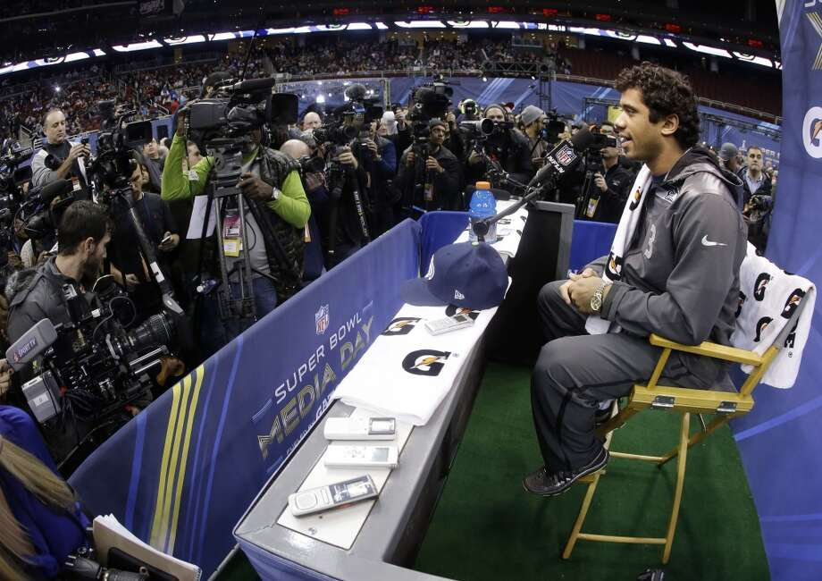 Seattle Seahawks' Russell Wilson answers a question during media day for the NFL Super Bowl XLVIII football game Tuesday, Jan. 28, 2014, in Newark, N.J. (AP Photo/Mark Humphrey) Photo: Mark Humphrey, AP