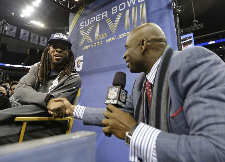 Deion Sanders shakes hands with Seattle Seahawks' Richard Sherman during media day for the NFL Super Bowl XLVIII football game Tuesday, Jan. 28, 2014, in Newark, N.J. (AP Photo/Jeff Roberson) Photo: Jeff Roberson, AP