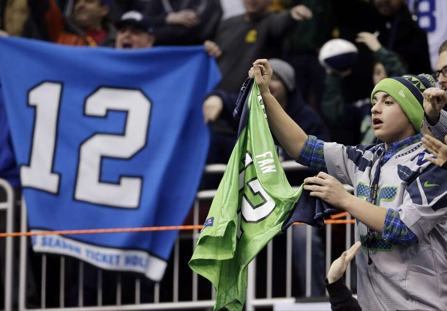Seattle Seahawks fans cheer during media day for the NFL Super Bowl XLVIII football game Tuesday, Jan. 28, 2014, in Newark, N.J. (AP Photo/Charlie Riedel) Photo: Charlie Riedel, AP