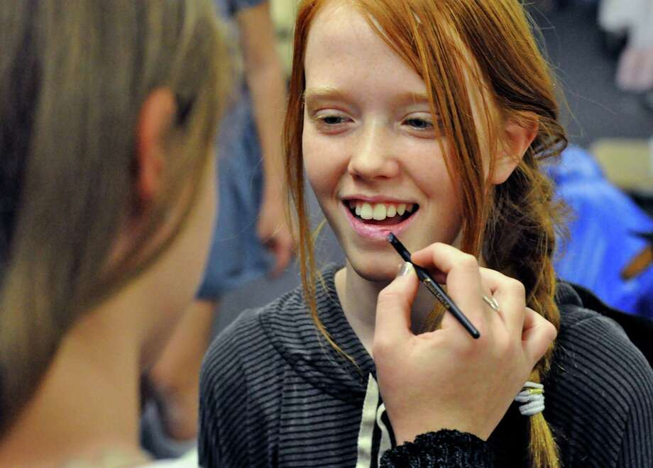 The Darien Arts Center will offer a two-day workshop on makeup application for stage and beauty on Feb.y 8 and 15. Charlotte Haight has lipstick applied during a recent event at the DAC. Photo: Contributed Photo, Contributed / Darien News