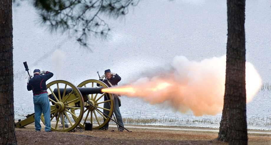 """I never liked that tree anyway:Re-enactors representing Kolb's Battery Alabama Light Artillery fire a 6-pound   cannon during a """"Civil War skirmish"""" at Lake DeFuniak in DeFuniak Springs, Fla. Photo: Devon Ravine, Associated Press"""