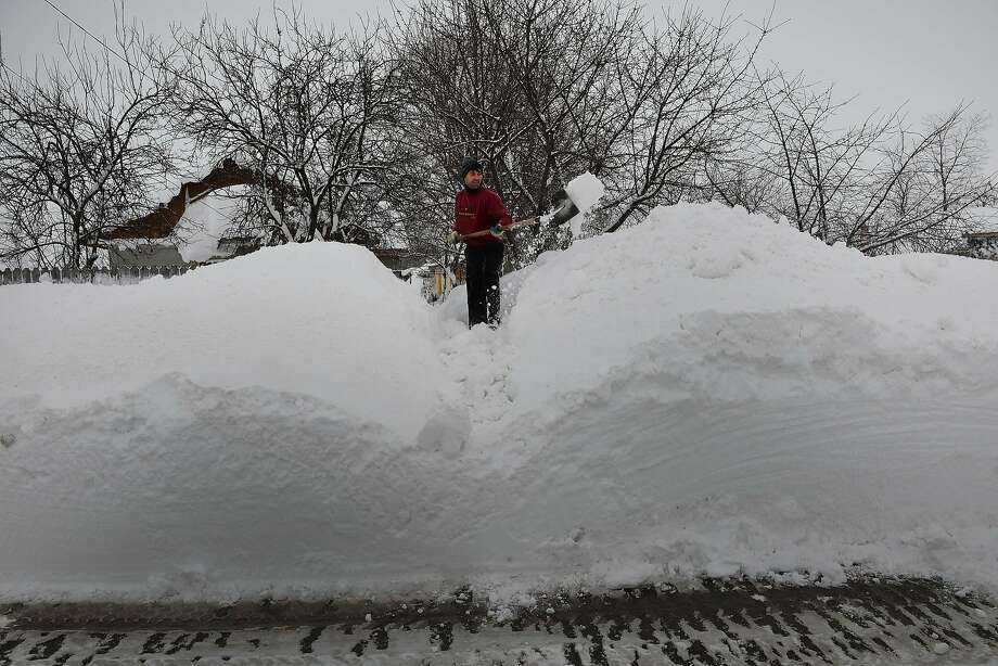 Plowed in: A Romanian homeowner digs out after another big snowstorm in the village of Smeeni east of Bucharest. Photo: Daniel Mihailescu, AFP/Getty Images