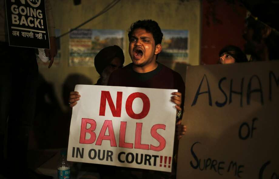 Delhi beef: In New Delhi, a gay-rights activist shouts slogans against a recent Supreme Court verdict that upheld an Indian 