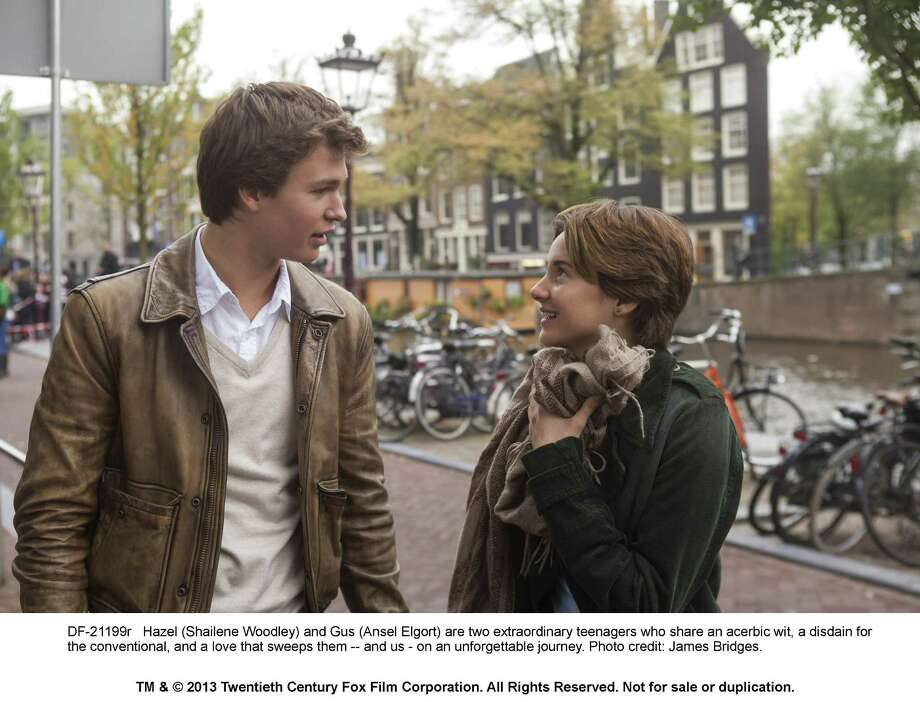 "Hazel (Shailene Woodley) and Gus (Ansel Elgort) during a memorable trip abroad in ""The Fault in Our Stars."" Photo: --, Photographer / TM and © 2013 Twentieth Century Fox Film Corporation. All Rights Reserved. Not for Sale or Duplication."