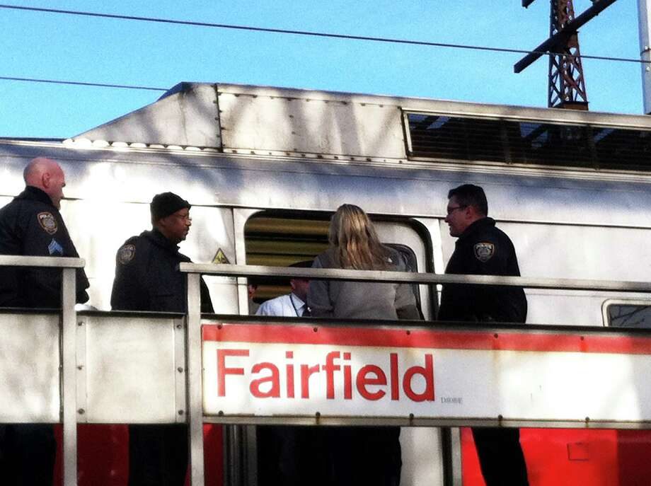 Police investigate the report of a sexual assault on a Metro-North train, which pulled into the downtown railroad station shortly after the incident was reported Tuesday morning. Photo: Genevieve Reilly / Fairfield Citizen
