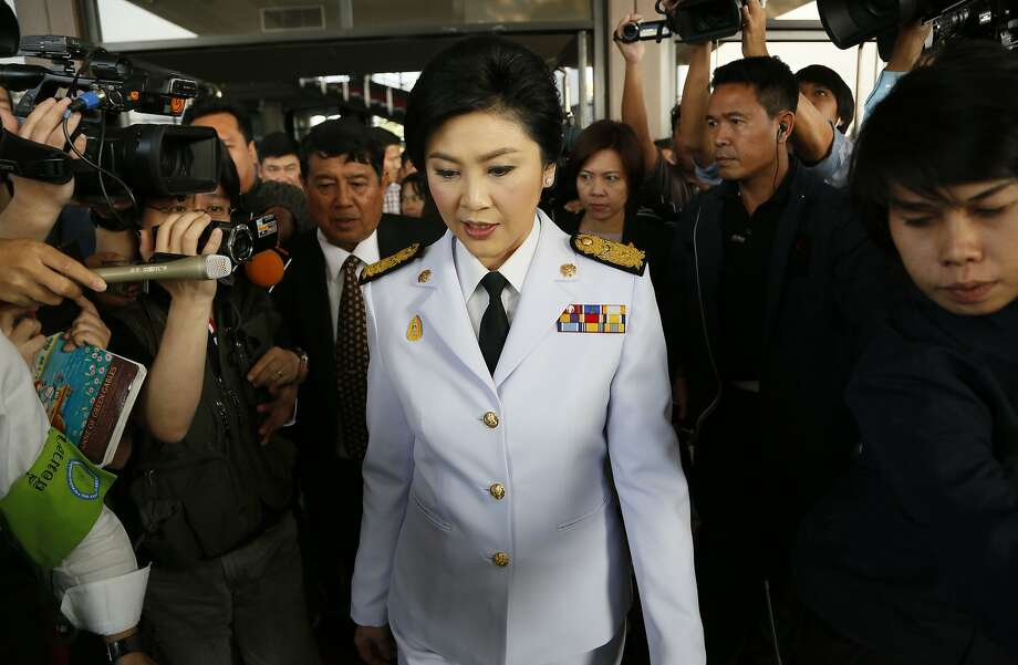 Thailand's Prime Minister Yingluck Shinawatra leaves a meeting with election commissioners at the Army Club, Tuesday, Jan. 28, 2014, in Bangkok, Thailand. Thailand's government announced Tuesday it will go ahead with an election this weekend despite months of street protests and an opposition boycott. (AP Photo/Wally Santana) Photo: Wally Santana, Associated Press