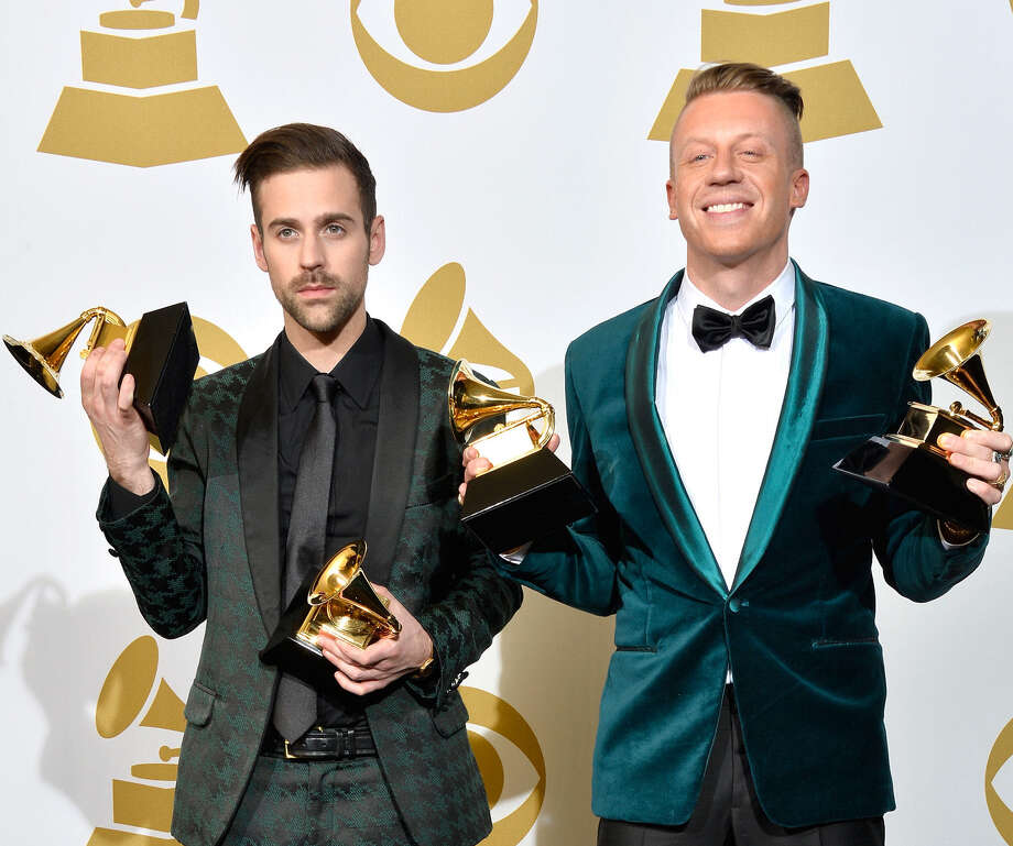 Ryan Lewis (left) and Macklemore hold the Grammys they won Sunday. Photo: Getty Images / 2014 Getty Images
