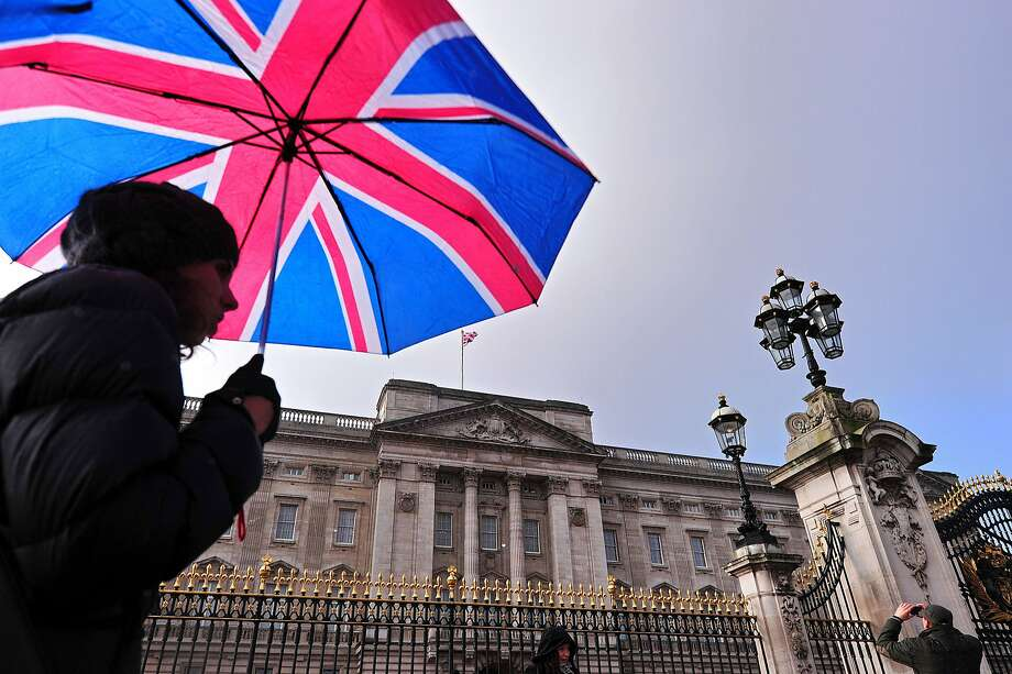 A tourist walks past Buckingham Palace in central London, on January 28, 2014. British lawmakers on Tuesday took aim at Queen Elizabeth II's household accountants, saying they must cut their costs and tackle a huge backlog of repairs to the monarch's crumbling palaces. Some of Buckingham Palace's 775 rooms have not been refurbished for 60 years, a palace official told MPs. AFP PHOTO / CARL COURTCARL COURT/AFP/Getty Images Photo: Carl Court, AFP/Getty Images
