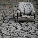 Chairs sit in dried and cracked earth that used to be the bottom of the Almaden Reservoir  on January 28, 2014 in San Jose, California. Now in its third straight year of drought conditions, California is experiencing its driest year on record, dating back 119 years, and reservoirs throughout the state have low water levels. Santa Clara County reservoirs are at 3 percent of capacity or lower. California Gov. Jerry Brown officially declared a drought emergency to speed up assistance to local governments, streamline water transfers and potentially ease environmental protection requirements for dam releases.