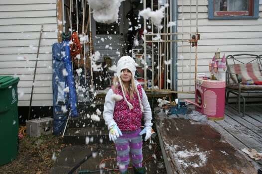 Isabella, age 8, with a makeshift snowball in the Heights
