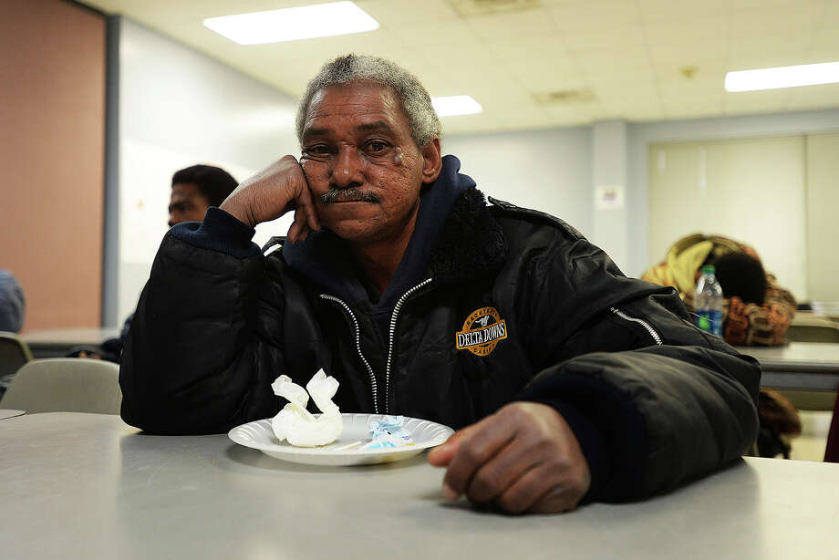 Jerry Ceaser, 54, sits inside of the Salvation Army shelter hoping to keep warm during the freezing temperature Tuesday. Michael Rivera/@michaelrivera88