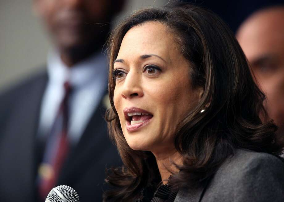 "FILE - This Nov. 16,2012 file photo shows California Attorney General Kamala Harris speaking during a news conference in Los Angeles. President Barack Obama praised Harris for more than her smarts and toughness at a Democratic Party event Thursday, April 4, 2013. The president also commended  Harris for being ""the best-looking attorney general"" during a Democratic fundraising lunch in the Silicon Valley.(AP Photo/Richard Vogel,File) Photo: Richard Vogel, Associated Press"