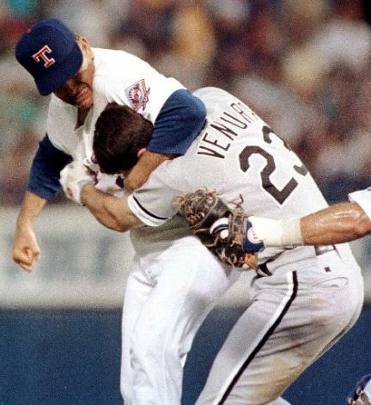 Nolan Ryan vs. Robin Ventura In 1993, Robin Ventura thought it would be a good idea to charge the mound, but the 46-year-old Nolan Ryan taught the 26-year-old Ventura a lesson. After being hit in the leg by a pitch, Ventura took a couple slow steps toward the mound before charging. That's when Ryan strapped on a headlock and unleashed a flurry of punches. Amazingly, Ryan wasn't ejected from the game, because umpires rules he had every right to defend himself.