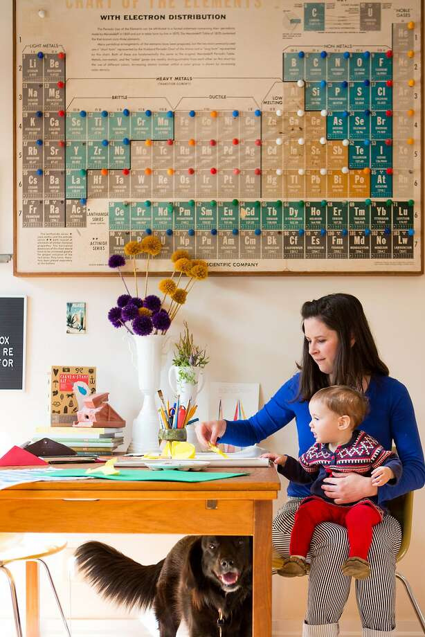 Christine Schmidt, daughter Emmy Gross and dog Clementine at their kitchen table in Noe Valley.