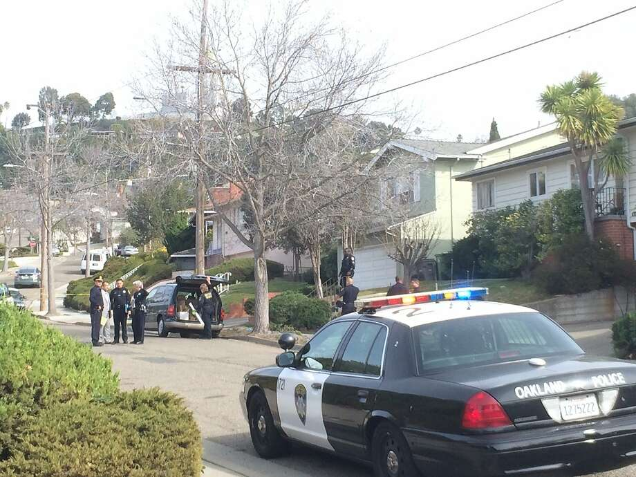 Oakland police investigate the shooting of an 81-year-old woman by an intruder inside her home on Laguna Avenue on Jan. 28, 2014. Photo: Henry K. Lee, The Chronicle