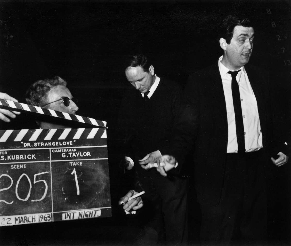 Peter Sellers, left, and director Stanley Kubrick, right, with a clapperboard during the filming of 'Dr Strangelove or How I Learned to Stop Worrying and Love the Bomb'.