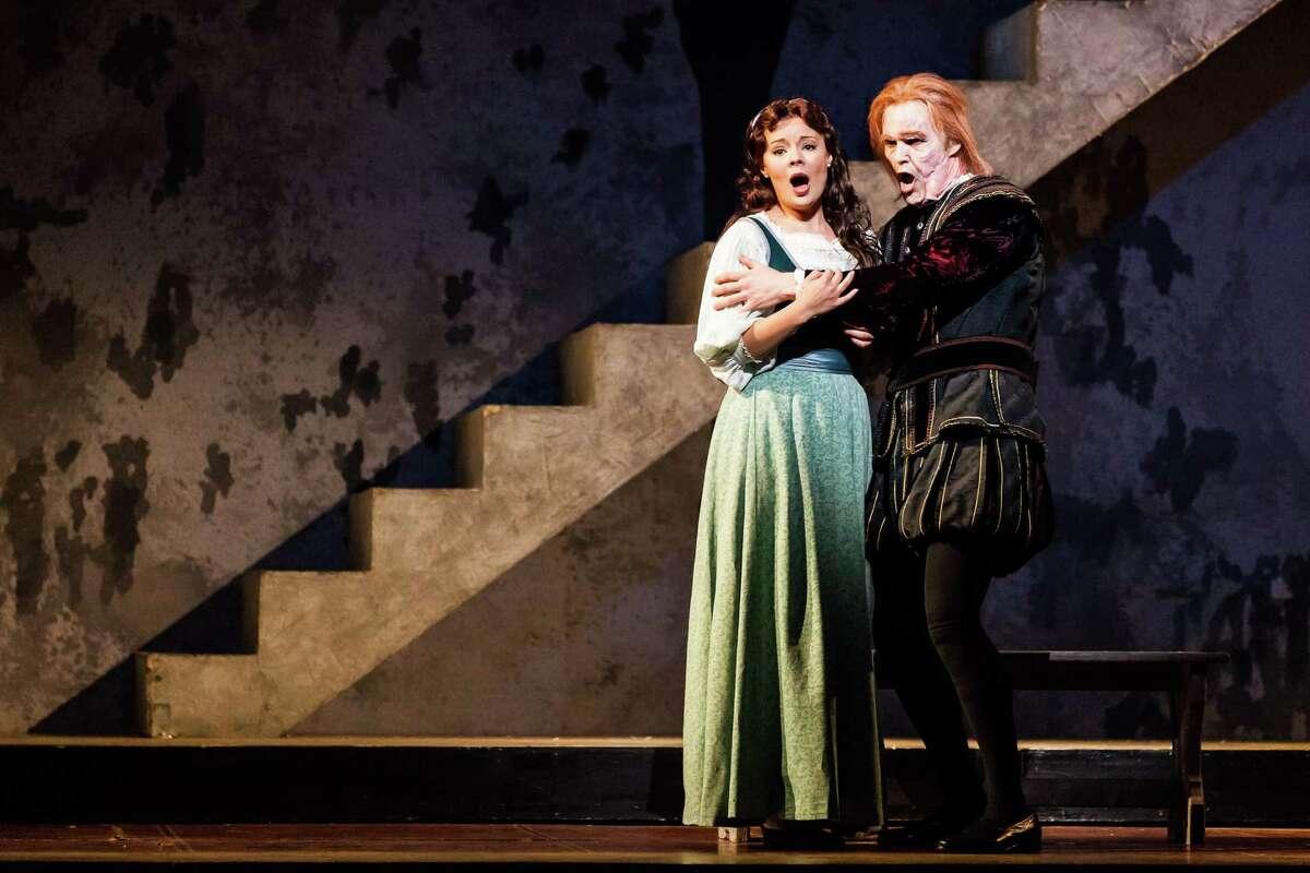 "Uliana Alexyuk, left, plays Gilda and Ryan McKinny plays Rigoletto in Houston Grand Opera's staging of Giuseppe Verdi's ""Rigoletto."""