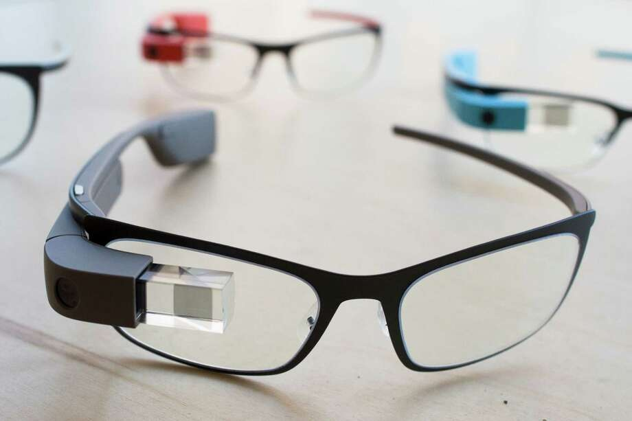 "The new Google Glass ""Bold"" prescription frames in ""shale"" color rests on a table at the Google Glass Basecamp space at Chelsea Market, Friday, Jan. 24, 2014, in New York. (AP Photo/John Minchillo) Photo: John Minchillo, Associated Press / Associated Press contributed"