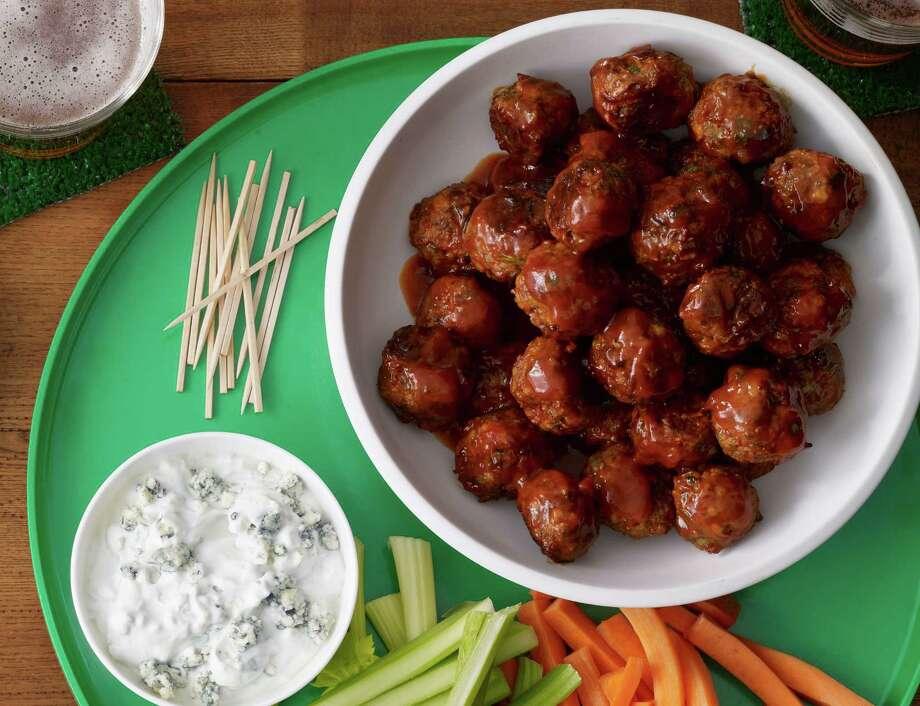 Buffalo-Buffalo Meatballs make for perfect bite-size Super Bowl treats. Photo: Food Network/Kana Okada, Photographer / Kana Okada 2013