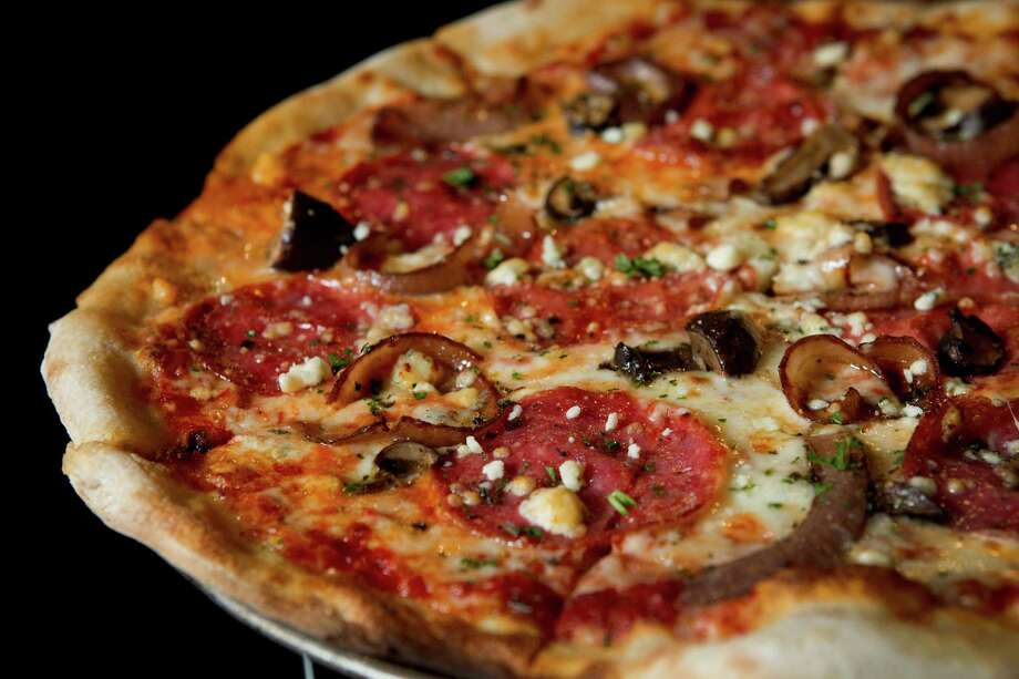 Crisp Wine, Beer and Eatery in Shady Acres is chiming in with their take on a hot new food trend: a local joint that puts alcohol and food on the same pedestal. Did this eatery succeed? Find out what Houston Chronicle food critic Alison Cook says about it.Take a look at the mouthwatering food, like this Toscano pizza, and drinks at Crisp. Photo: Brett Coomer, Staff / © 2014 Houston Chronicle