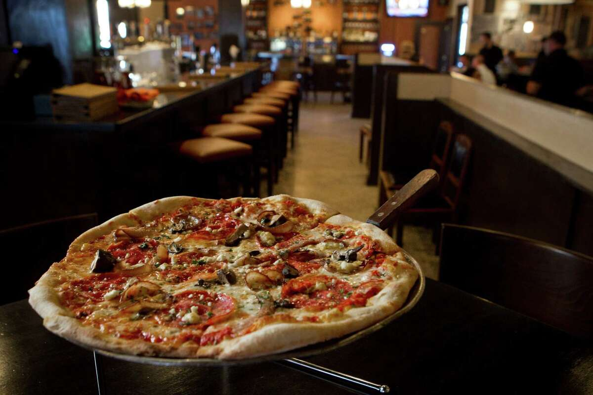 Pizza Toscana pizza is a delightful offering to pair with beer or wine at Crisp.=