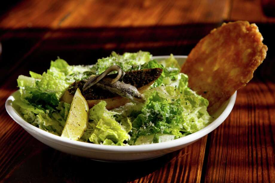A Caesar salad with a parmesan crisp is shown at Crisp. Photo: Brett Coomer, Staff / © 2014 Houston Chronicle