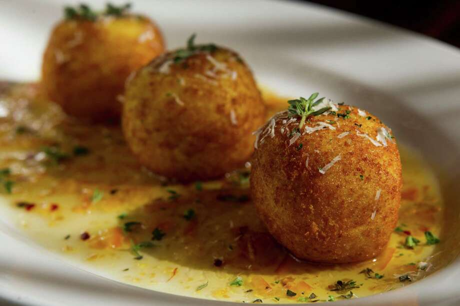 Three's company: Arancini is shown at Crisp. Photo: Brett Coomer, Staff / © 2014 Houston Chronicle
