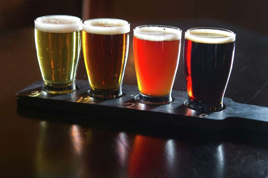 Bottoms up: a beer flight from Crisp. Photo: Brett Coomer, Staff / © 2014 Houston Chronicle