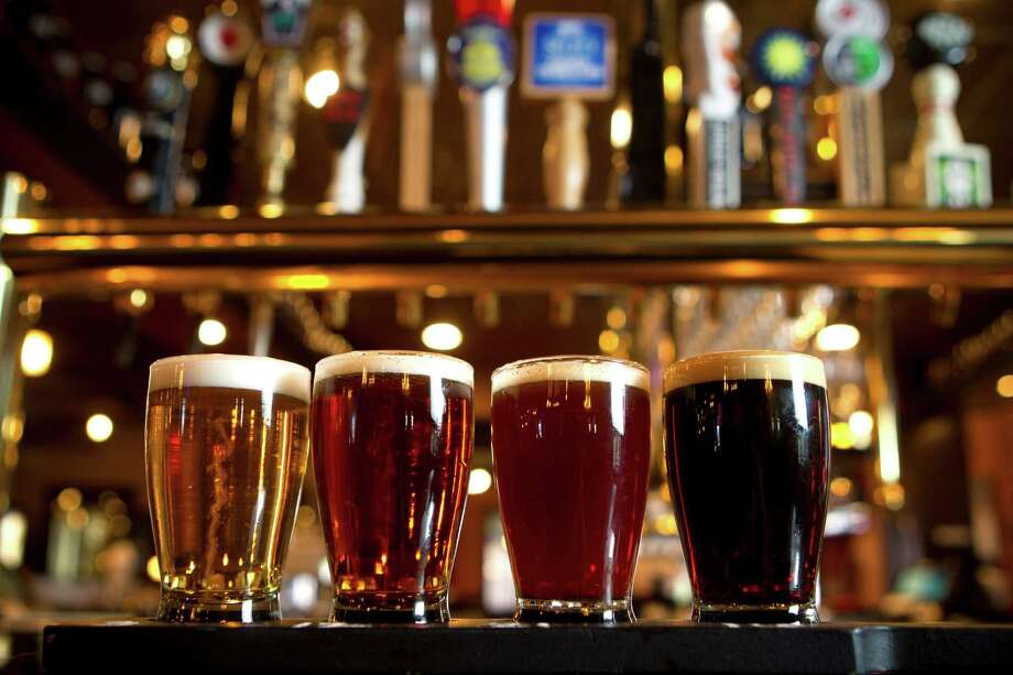 This restaurant pays equal attention to its alcohol selection. Here, a beer flight is shown in front of the taps at Crisp. Photo: Brett Coomer, Staff / © 2014 Houston Chronicle