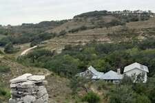 Phil Evett chose a spot in the valley of his 20-acre property in Blanco as the location of his house.