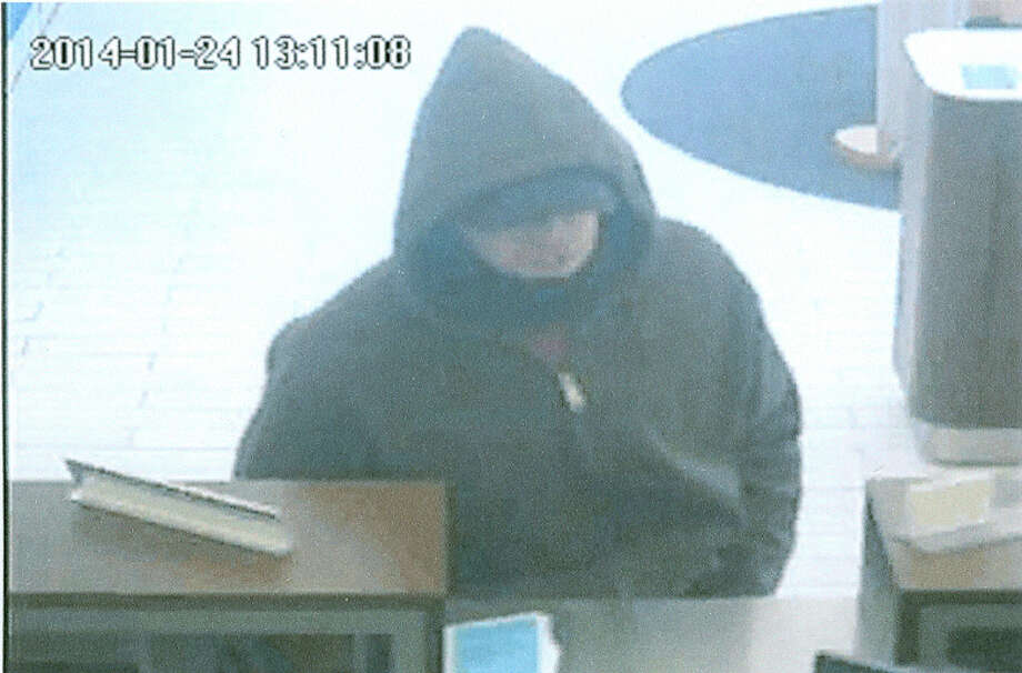 On Friday, January 24, 2014, at little after 1p.m., the Ridgefield Police Department responded to a bank robbery at the First Niagara Bank at 108 Danbury Road in Ridgefield, Conn. The suspect (in photo above) entered the bank and demanded cash from the teller. The suspect then left the bank on foot with an undisclosed amount of cash. Photo: Contributed Photo / The News-Times Contributed