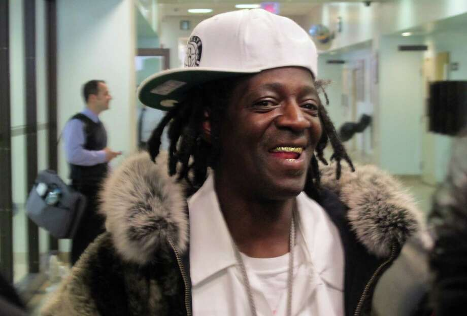 Flavor Flav speaks with reporters following an appearance in Nassau County District Court in Hempstead, N.Y., on Tuesday, Jan. 28, 2014. The rapper, whose real name is William Drayton, was in court on charges he was speeding and driving with a suspended license en route to his mother's funeral in Long Island on Jan. 9. Drayton pleaded not guilty Tuesday and was released without bail. (AP Photo/Frank Eltman) ORG XMIT: RPFE101 Photo: Frank Eltman / AP