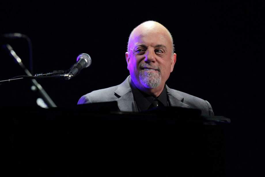 Billy Joel performs his first show of his Madison Square Garden residency, on Monday, Jan. 27, 2014, in New York. (Photo by Greg Allen/Invision/AP) ORG XMIT: NYGA106 Photo: Greg Allen / Invision