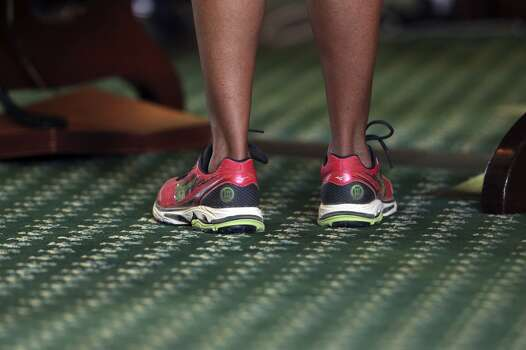 Her pink sneakers become an icon for Fort Worth Sen. Wendy Davis' filibuster. Photo: TOM REEL, San Antonio Express-News