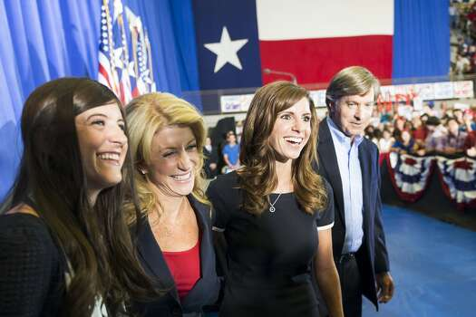 Davis stands wither her daughters Dru, left, and Amber as wells her and boyfriend, former Austin Mayor Will Wynn, after she announced her candidacy Oct. 3, 2013. Photo: Smiley N. Pool, Houston Chronicle