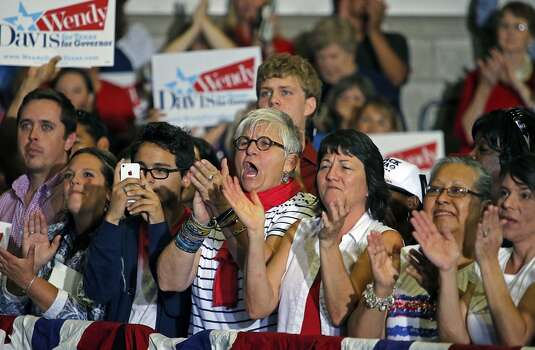 Supporters cheer for Davis at the W.G. Thomas Coliseum in Haltom City on Oct. 3, 2013. She chose the location to announce because that is where she walked the stage to accept her high school diploma. Photo: Stewart F. House, Getty Images